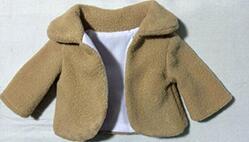给沙龙娃娃制作一件漂亮的小外套。