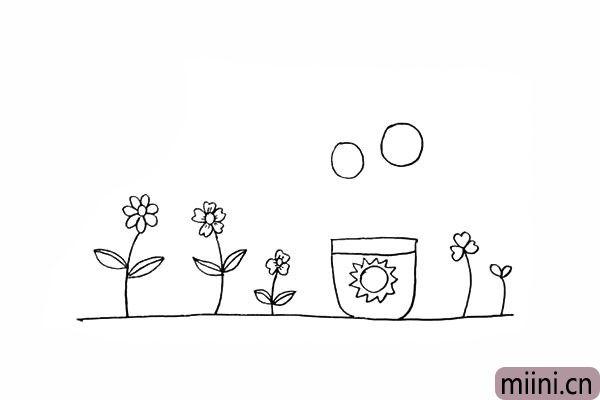11.在花盆的上方画出两个大小不一的圆。