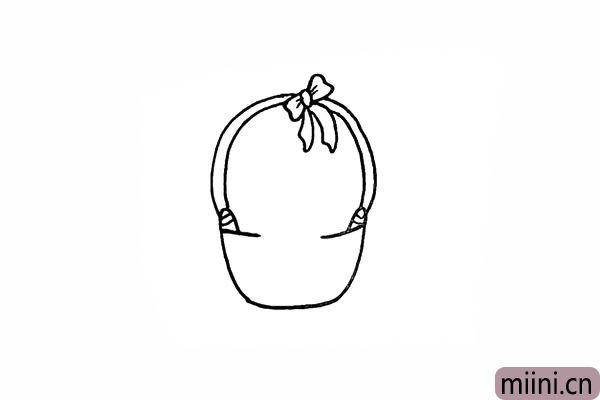 4.在篮把顶部画上一个漂亮的蝴蝶结。