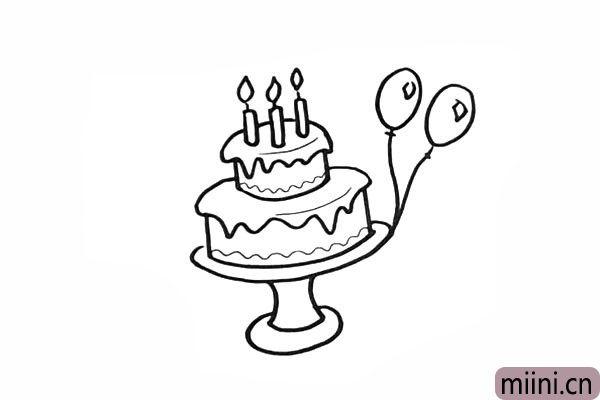 10.在把蛋糕装饰一下.旁边画两个气球。