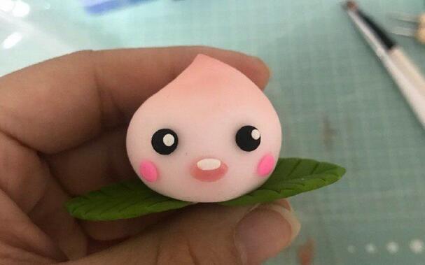 可爱的粘土粉色小桃子做法