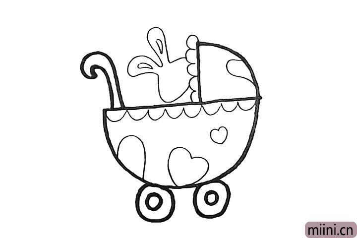 7.推车画好以后.在里画上一只小兔子。