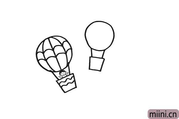 8.同样的画法.再画上另一个热气球。