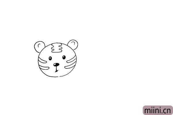 第六步:在画出它的两只圆耳朵.注意位置。