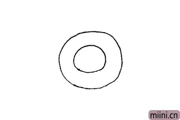 第一步:先画上一个圆形,里面再画上一个小的圆形作为盘子。