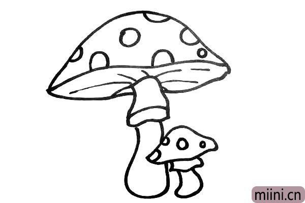 第八步.再用大小不同的圆圈.把蘑菇顶装饰一下。