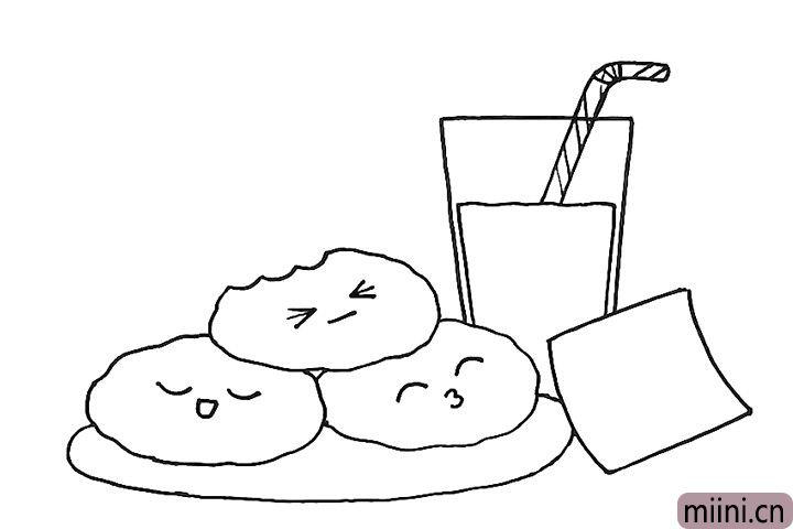 6.给三块饼干画上可爱的表情。
