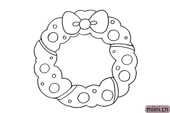 5.在花环上画一些圆圈做装饰。