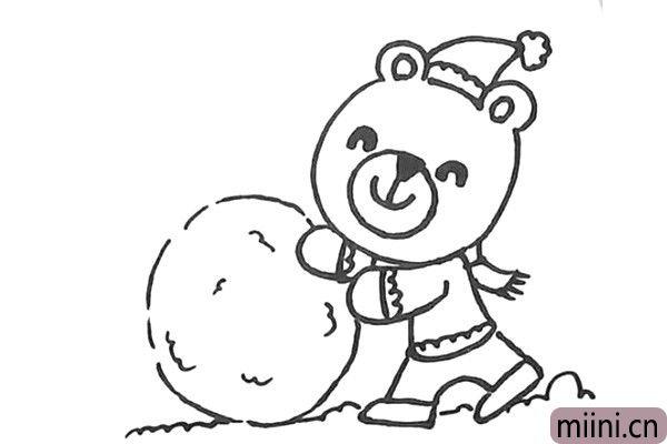 6.画小熊推着的雪球,再用波浪线画上雪地。