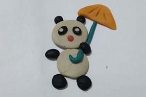 简单彩泥打雨伞熊猫的制作步骤图解教程